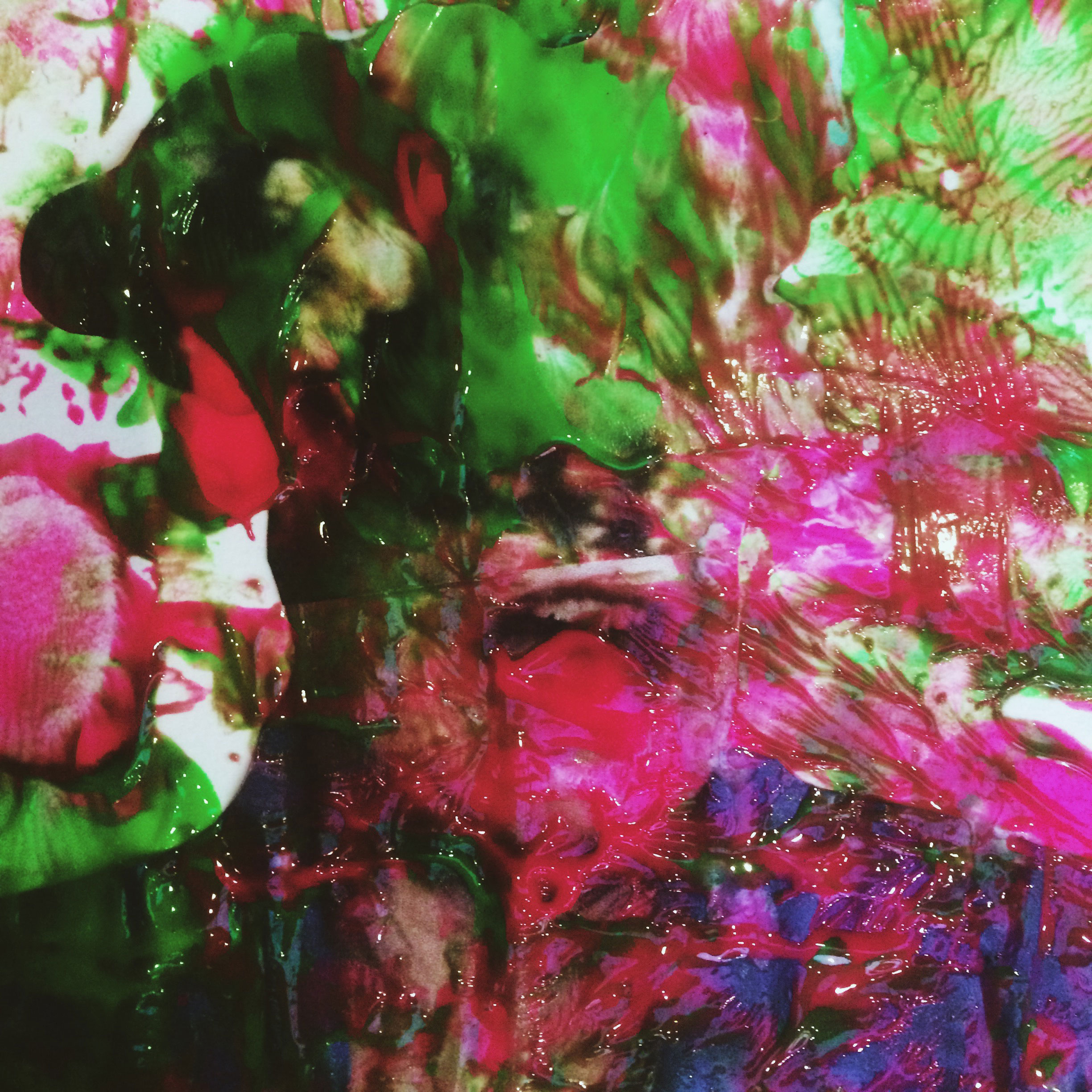 Artwork by Lily Wales, a collage showing a distorted face in lime green and bright pink